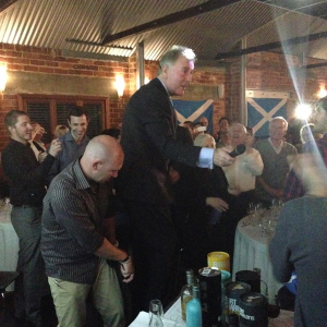 Jim holding court and leading the room in a boisterous version of the Scottish national anthem